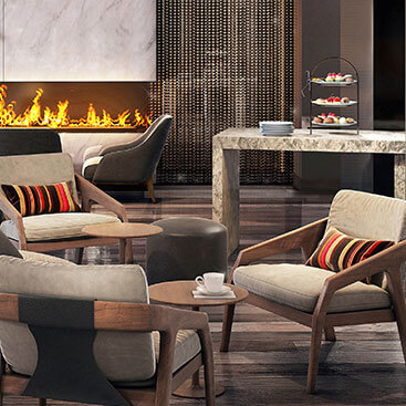 lounge area with tan chairs and fireplace